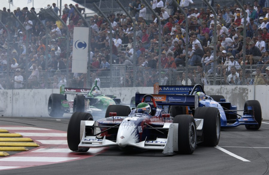 08/31/03 Denver, Co. Darren Manning battles with Alex Tagliani and Mario Dominguez during the Centrix Financial Grand Prix of Denver. Photo credit: Autostock