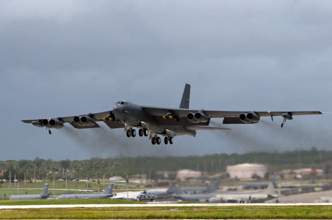 A B-52 bomber, deployed at Andersen Air Force Base, Guam, from Barksdale Air Force Base, La., takes off for Septemberís Koa Lightning exercise.  For the first time, B-52 crews dropped inert munitions on Pele Bombing Range, Hawaii.  The munitions are made from concrete and have GPS guidance, which make them safe for the environment. This training provides valuable simulated combat experience for the aircrews and translates into raw global combat power against the continuing war on terrorism. (U.S. Air Force photo/Senior Master Sgt. Mahmoud Rasouliyan)