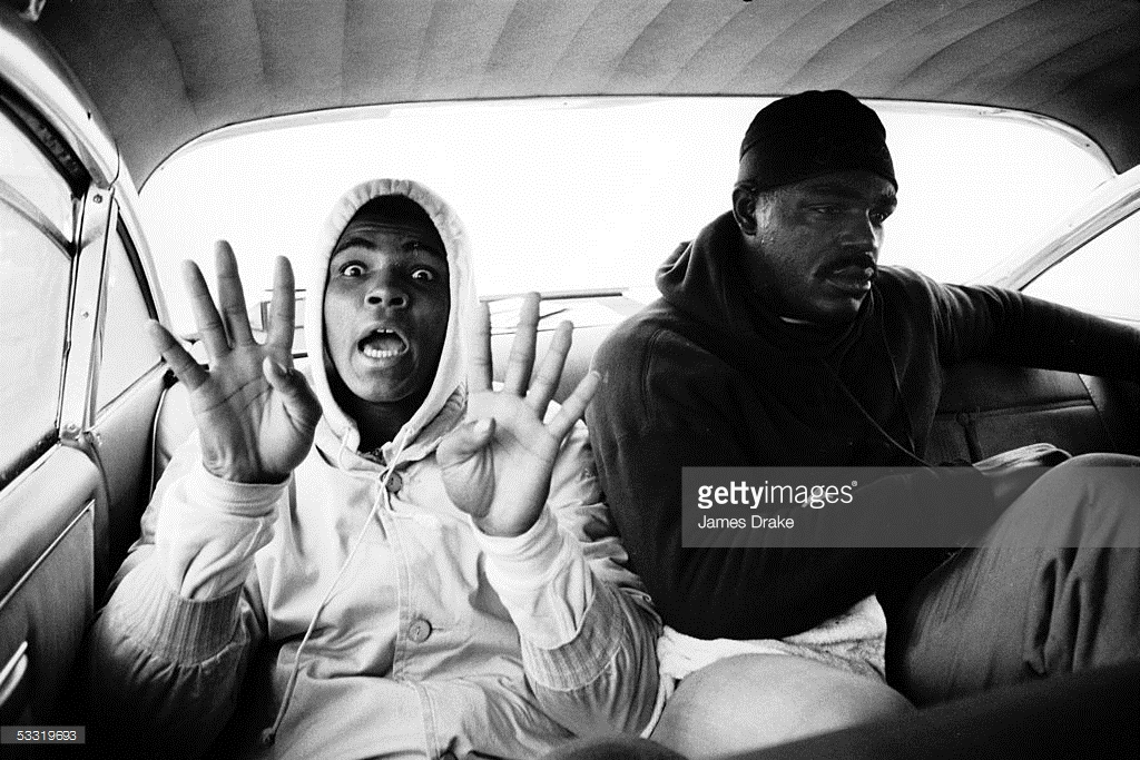 Date taken: 1963 Description: Boxer Cassius Clay (L) aka Muhammad Ali holding up eight fingers, prob. in reference to number of rounds it will take him to knock out his opponent. City: Louisville State: KY Country: US cr: James Drake/Time & Life Pictures/Getty Images NOT OWNED