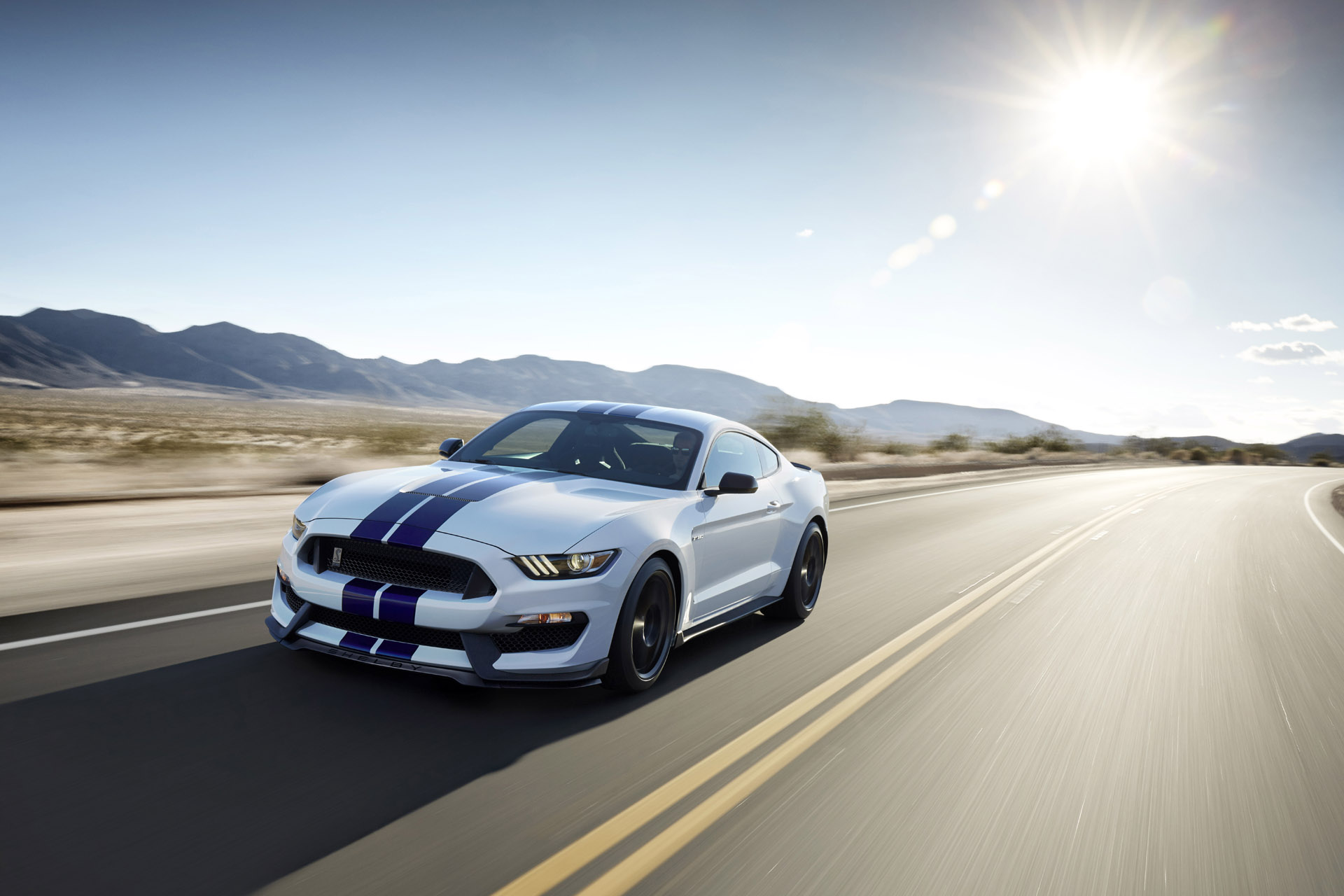 The All-new Shelby GT350 Mustang in Oxford White with a Sonic Blue stripe.