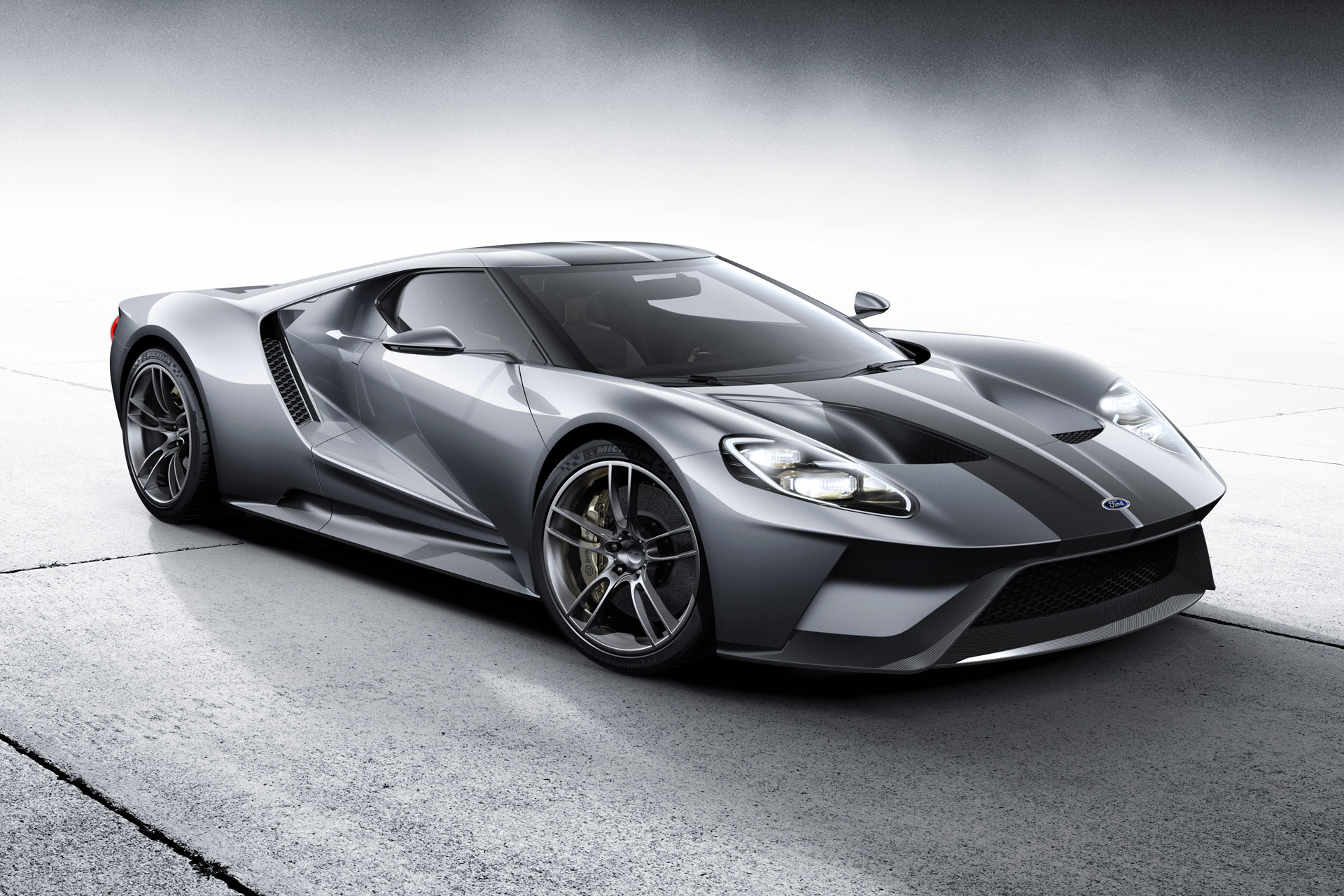 The all-new, carbon-fiber, mid-engined Ford GT supercar, expected to go into production in 2016, will redefine innovation in aerodynamics, EcoBoost and light-weighting. Shown in Liquid Silver with black racing stripes at the 2015 Chicago Auto Show.